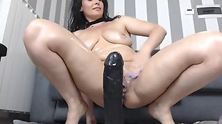 Hot big tits brunette plays with huge anal dildo squirting