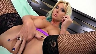 Stockinged Alysha stretches slit with fingers, fist and toys